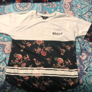 A long sleeve shirt with flowers on it